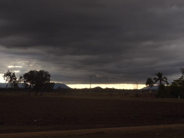 Storm cloud approaching dry landscape