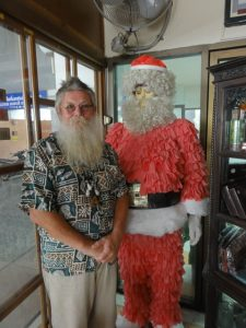 Peder standing next to a Santa dummy