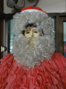 Shop santa with coat made entirely out of condoms